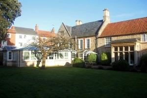 The care home gardens and conservatory